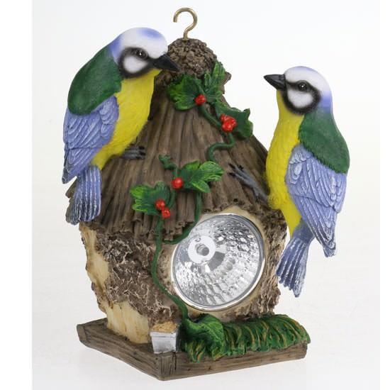 Deko-Vogelhaus aus Kunststein mit Solar-Lampe. Deko-Vogelfiguren mit LED